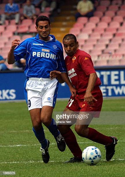 Nicola Amoruso of Napoli and Emerson of Roma in action during the Serie A 33rd Round League match between Napoli and Roma played at the San Paolo...