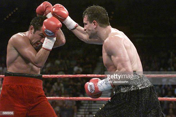 Oscar De La Hoya blocks out the punches of Javier Castillejo during WBC Super Welterweight Championship bout at the MGM Grand Hotel Casino in Las...