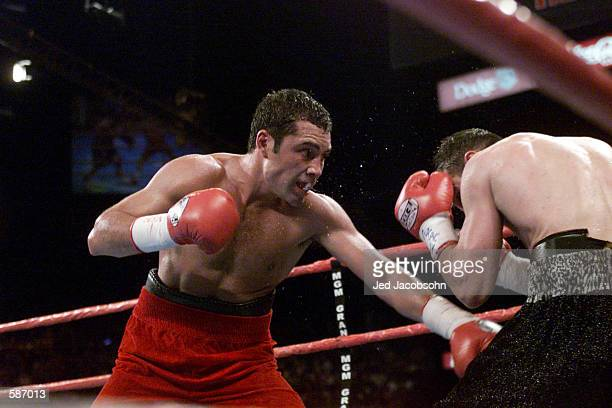 Oscar de La Hoya delivers a low punch against Javier Castillejo during WBC Super Welterweight Championship bout at the MGM Grand Hotel Casino in Las...