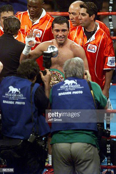 Oscar De La Hoya faces the press as he celebrates his victory over Javier Castillejo after the WBC Super Welterweight Championship bout at the MGM...