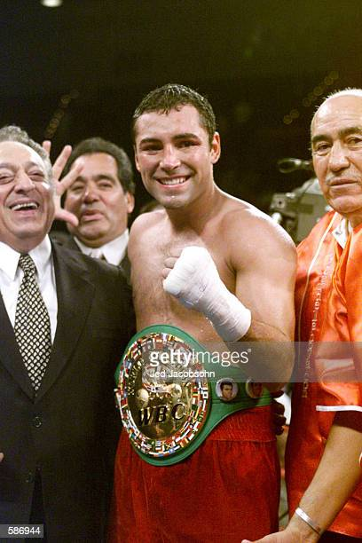 Oscar De La Hoya poses with his belt after defeating Javier Castillejo during the WBC Super Welterweight Championship bout at the MGM Grand Hotel...