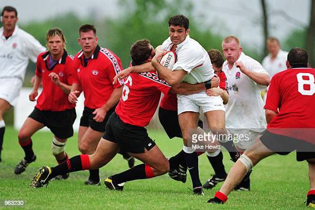 Pat Sanderson of England is tackled by Dale Burleigh of Canada during the match played at Fletchers Fields in Markham in Toronto, Canada, as part of...