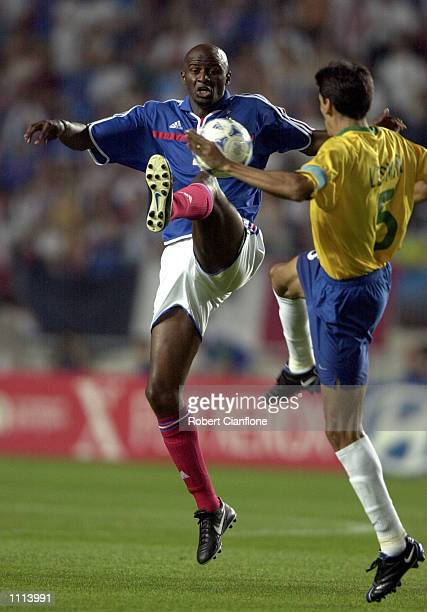 Patrick Vieira#4 of France is challenged by Leomar of Brazil, during the 2001 FIFA Confederations Cup semi final between France and Brazil played at...