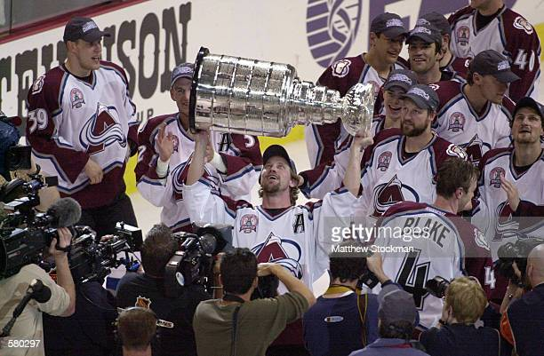 Peter Forsberg of the Colorado Avalanche holds up the Stanley Cup after defeating the New Jersey Devils in game seven of the NHL Stanley Cup Finals...