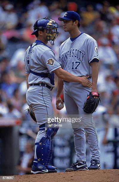 Pitcher Mac Suzuki and Catcher A J Hinch of the Kansas City Royals talk at the mound during the game against the Anaheim Angels at Edison Field in...