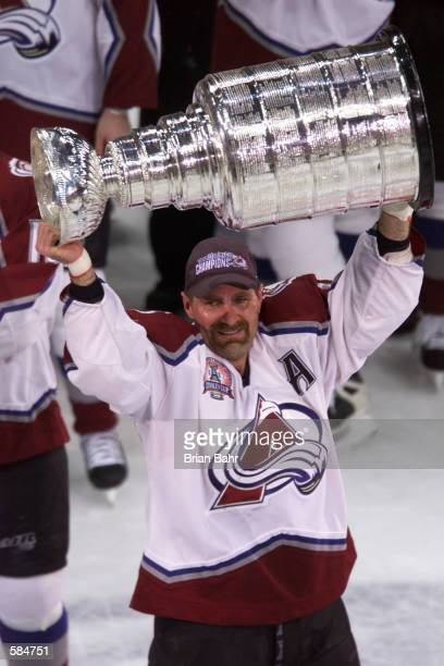 Ray Bourque of the Colorado Avalanche hoists the Stanley Cup after defeating the New Jersey Devils during the Stanley Cup finals at the Pepsi Center...