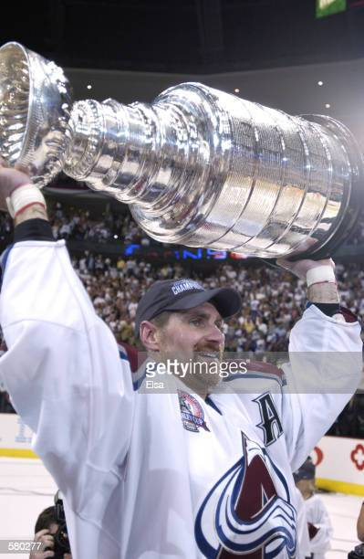 Ray Bourque of the Colorado Avalanche lifts the Stanley Cup after they defeated the New Jersey Devils 31 in game seven of the NHL Stanley Cup Finals...
