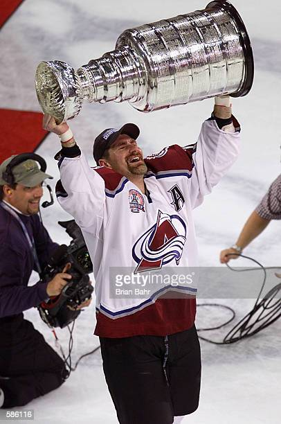 Ray Bourque of the Colorado Avalanche skates away with the Stanley Cup after 22 seasons in pursuit of the NHL Stanley Cup Championship. Denver,...