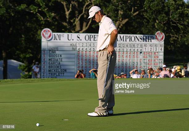 Retief Goosen of South Africa misses his second putt on the 18th green during the final round of the 101st US Open at Southern Hills Country Club in...