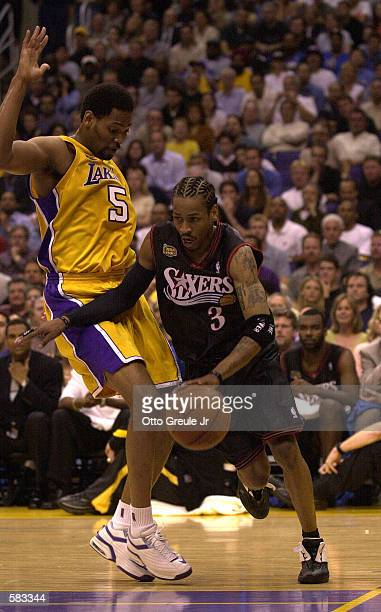 Robert Horry of the Los Angeles Lakers defends Allen Iverson of the Philadelphia 76ers in Game 1 of the NBA Finals at Staples Center in Los Angeles,...