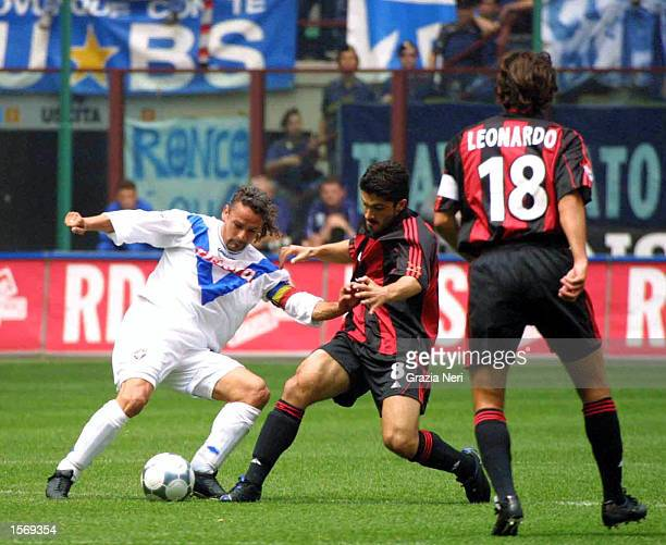 Roberto Baggio of Brescia and Gennaro Gattuso of AC Milan in action during the Serie A 33rd Round League match between AC Milan and Brescia played at...