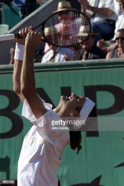 Roger Federer of Switzerland celebrates after winning his fourth round match against Wayne Arthurs of Australia during the French Open Tennis at...