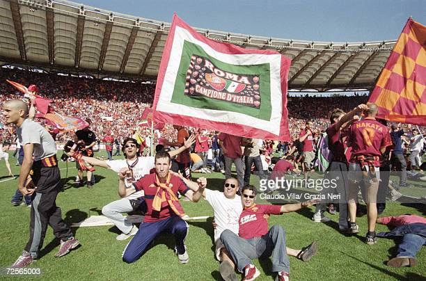 Roma fans celebrate the Scudetto by invading the pitch after a 3-1 victory in the Serie A match against Parma at the Stadio Olimpico in Rome....