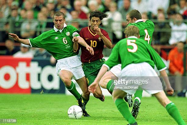 Rui Costa of Portugal tries to tackle Roy Keane of Republic of Ireland during the World Cup Qualifier between the Republic of Ireland and Portugal at...