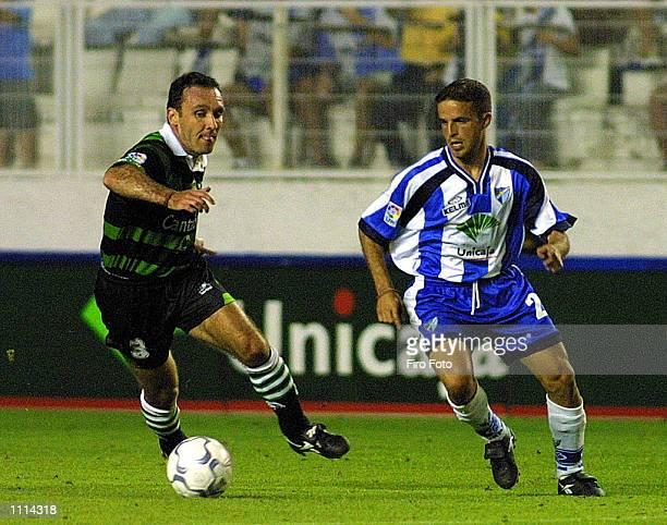 Sandro of Malaga and Espina of Racing Santander in action during the Primera Liga match played between Malaga and Racing Santander at La Rosaleda...