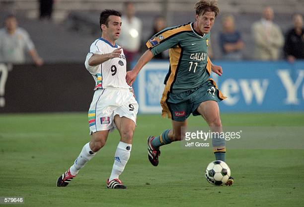 Sasha Victorine of the Los Angeles Galaxy fights for possession of the ball with Kerry Zavagnin of the Kansas City Wizards during the game at the...