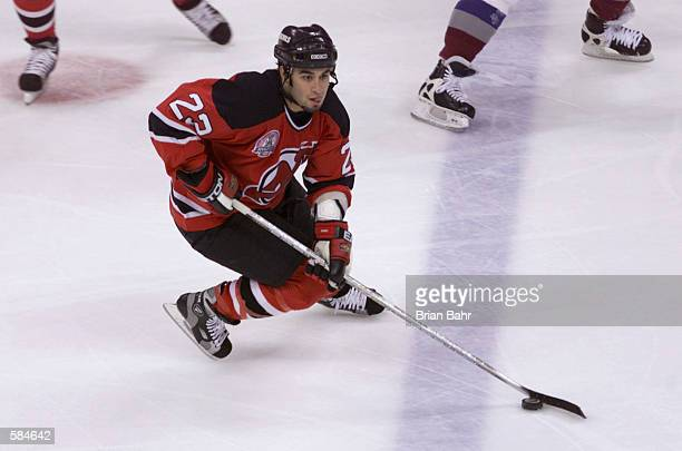 Scott Gomez of the New Jersey Devils brings the puck down ice against the Colorado Avalanche during game seven of the Stanley Cup finals at the Pepsi...