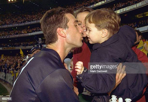 Stephen Silvagni for Carlton is congratulated by son Jack and wife Jo after playing his 300th game in the match between the Richmond Tigers and the...
