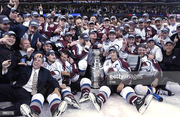 The Colorado Avalanche pose with the Stanley Cup after they defeated the New Jersey Devils 3-1 in game seven of the NHL Stanley Cup Finals at Pepsi...