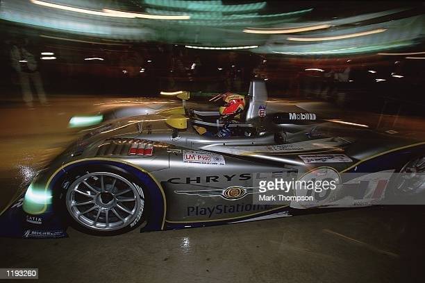 The Playstation Chrysler Team make a night time Pit Stop during the Le Mans 24 Hour Race at Circuit de la Sarthe in Le Mans France Mandatory Credit...
