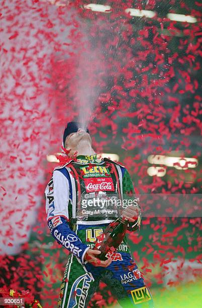 Tomasz Gollob of Poland sprays champagne after claiming third place at the British Speedway Grand Prix at the Millennium Stadium in Cardiff Wales...