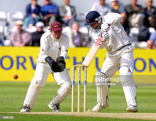 Warren Hegg of Lancashire cuts past wicketkeeper David Ripley of Northamptonshire as he notches up a match winning 107 not out on the final day of...