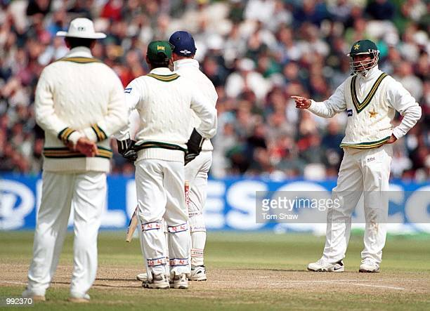 Pakistan palyers have words with batsman Graham Thorpe during the Second Npower Test match between England and Pakistan at Old Trafford Manchester...