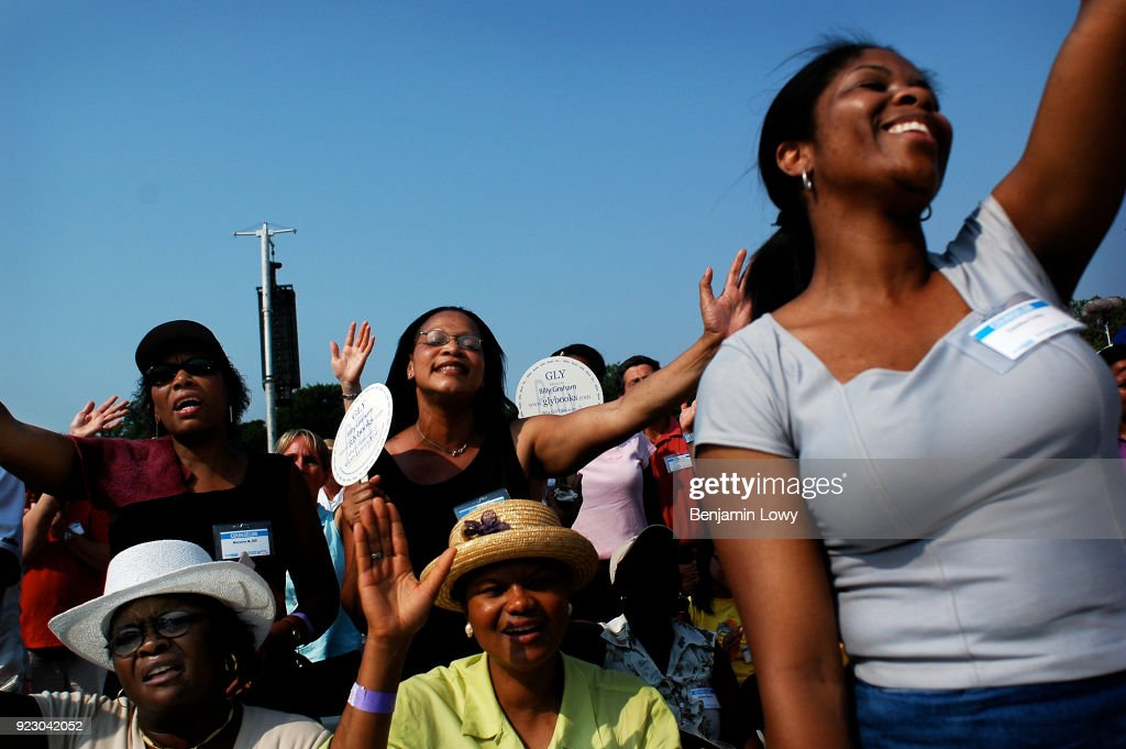 26 Jun 2005, Queens, New York, USA - Attendees of the Reverend Billy Graham's New York Crusade at Flushing Meadows Park in New York. Graham, 86, has preached the Gospel to more people in a live audience format than anyone in history: over 210 million people in more than 185 countries. This is said to be Graham's last live appearance.