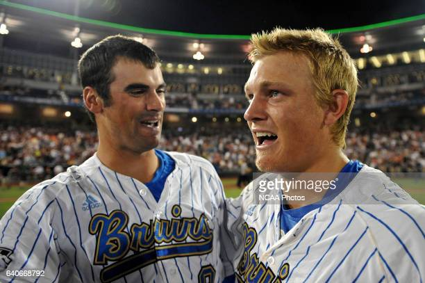 Adam Plutko and Pat Valaika of the University of California Los Angeles congratulate each other during the Division I Men's Baseball Championship at...