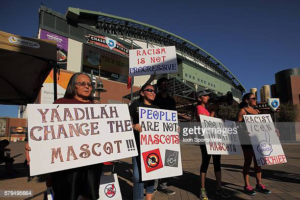 Native Americans Lita and Kristy Blackhorse Marcus Amanda Blackhorse and Tawnya Brown protest the use of the Chief Wahoo mascot by the Cleveland...