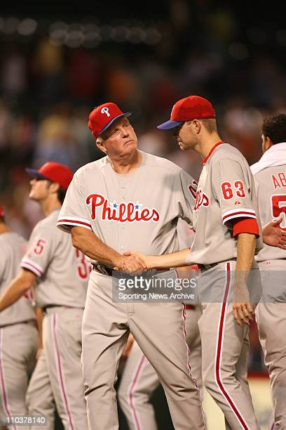 Jun 29 2006 Baltimore MD USA Philadelphia Phillies manager Charlie Manuel shakes hands with pitcher Ryan Madson against Baltimore Orioles at Orioles...