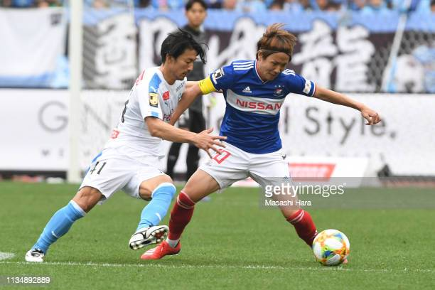 Jun Amano of Yokohama FMarinos and Akihiro Ienaga of Kawasaki Frontale compete for the ball during the JLeague J1 match between Yokohama FMarinos and...