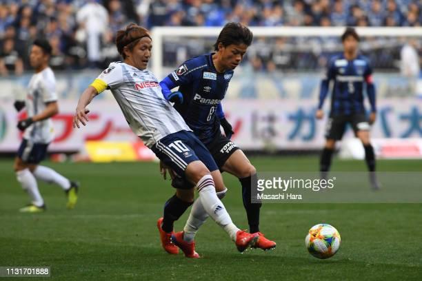 Jun Amano of Yokohama F.Marinos and Kosuke Onose of Gamba Osaka compete for the ball during the J.League J1 match between Gamba Osaka and Yokohama...