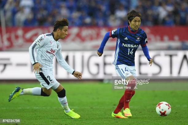 Jun Amano of Yokohama F.Marinos and Riku Matsuda of Cerezo Osaka compete for the ball during the J.League J1 match between Yokohama F.Marinos and...