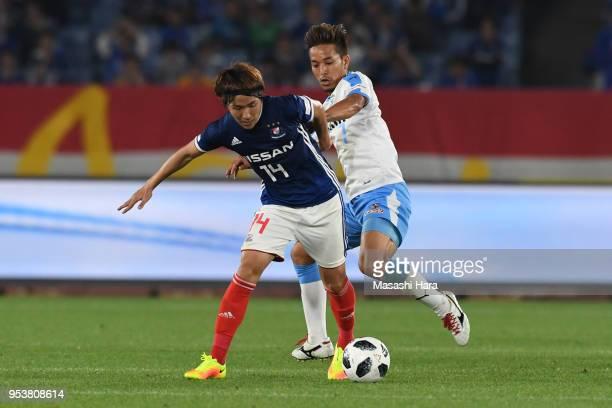 Jun Amano of Yokohama F.Marinos and Taishi Taguchi of Jubilo Iwata compete for the ball during the J.League J1 match between Yokohama F.Marinos and...