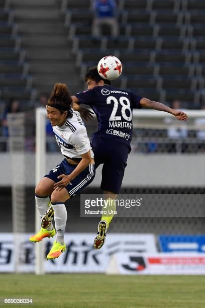 Jun Amano of Yokohama F.Marinos and Takuya Marutani of Sanfrecce Hiroshima compete for the ball during the J.League J1 match between Sanfrecce...