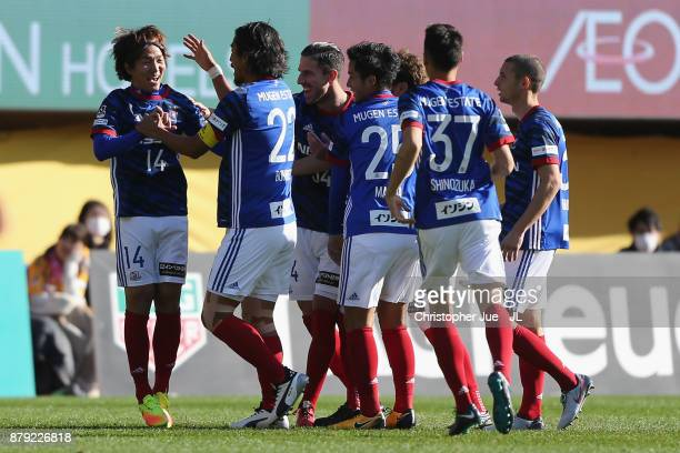 Jun Amano of Yokohama FMarinos celebrates scoring the opening goal with his team mates during the JLeague J1 match between Vegalta Sendai and...