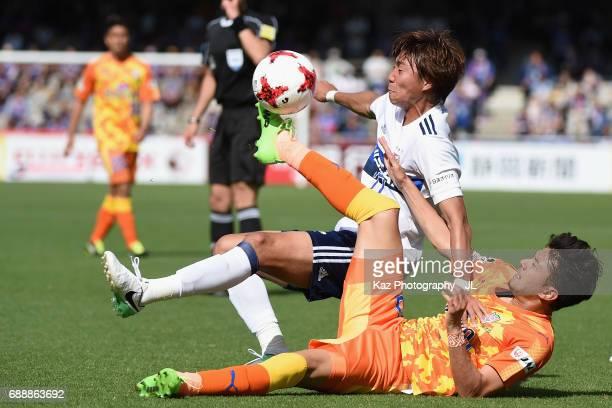 Jun Amano of Yokohama F.Marinos is challenged by Ryohei Shirasaki of Shimizu S-Pulse during the J.League J1 match between Shimizu S-Pulse and...