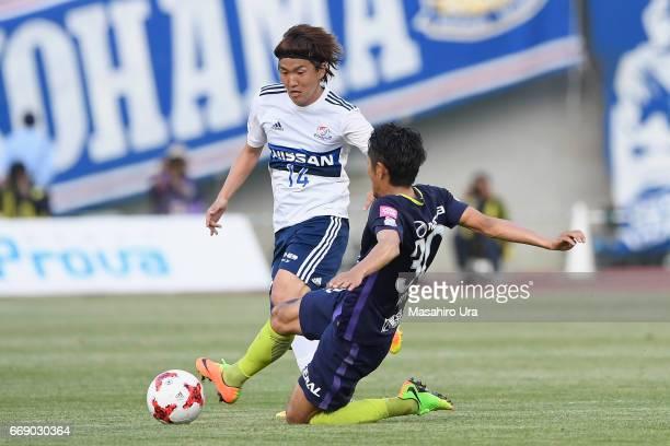 Jun Amano of Yokohama F.Marinos is tackled by Kosei Shibasaki of Sanfrecce Hiroshima during the J.League J1 match between Sanfrecce Hiroshima and...