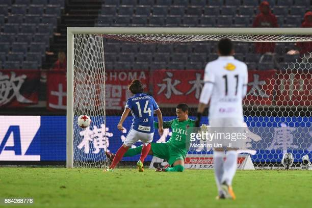 Jun Amano of Yokohama F.Marinos scores his side's second goal during during the J.League J1 match between Yokohama F.Marinos and Kashima Antlers at...