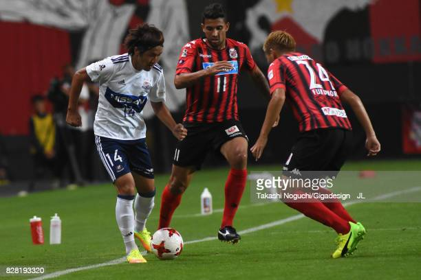 Jun Amano of Yokohama FMarinos takes on Reis and Akito Fukumori of Consadole Sapporo during the JLeague J1 match between Consadole Sapporo and...