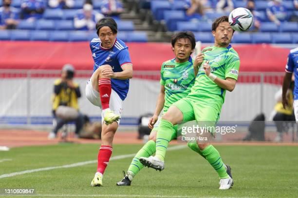 Jun Amano of Yokohama F.Marinos takes on Shota Kobayashi of Shonan Bellmare during the J.League Meiji Yasuda J1 match between Yokohama F.Marinos and...