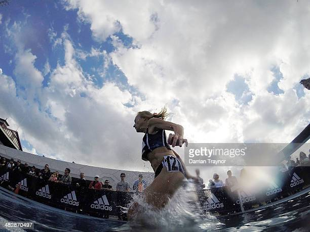 Jun An athlete jumps the water during the steeplechase during the 92nd Australian Athletics Championships at Olympic Park on April 5 2014 in...