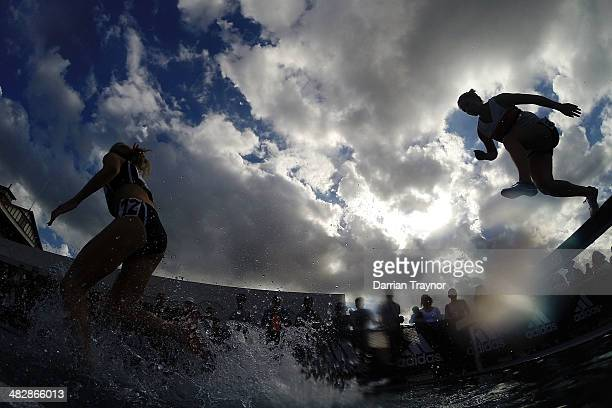 Jun Athletes jump the water during the steeplechase during the 92nd Australian Athletics Championships at Olympic Park on April 5 2014 in Melbourne...
