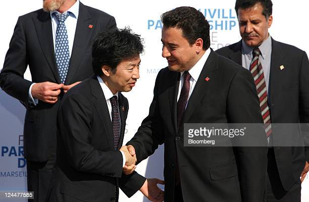 Jun Azumi Japan's finance minister left greets Ali Babacan Turkey's finance minister ahead of the family photograph during a meeting of the G7...