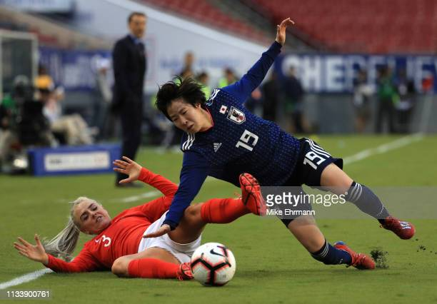 Jun Endo of Japan is challenged by Alex Greenwood of England during the 2019 SheBelieves Cup match between England and Japan at Raymond James Stadium...