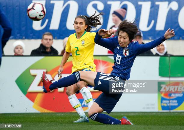 Jun Endo of Japan kicks the ball past Leticia S #2 of Brazil during the second half during the 2019 SheBelieves Cup match between Brazil and Japan at...