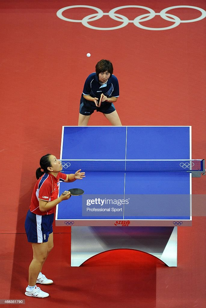Jun Gao of the USA (L) playing against Xue Wu of the Dominican Republic during their women's table tennis single preliminary match during Day 13 of the Beijing 2008 Olympic Games on August 21, 2008 in Beijing, China.