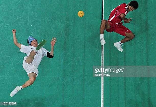 Jun Ho Lee of Korea trys to kick the ball past Aung Zaw Zaw of Myanmar during the Sepaktakraw Mens Double final between Korea and Myanmar at...