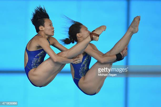 Jun Hoong Cheong and Mun Yee Leong of Malaysia compete in the Women's 10 meter synchro during the FINA/NVC Diving World Series at the Aquatics Centre...